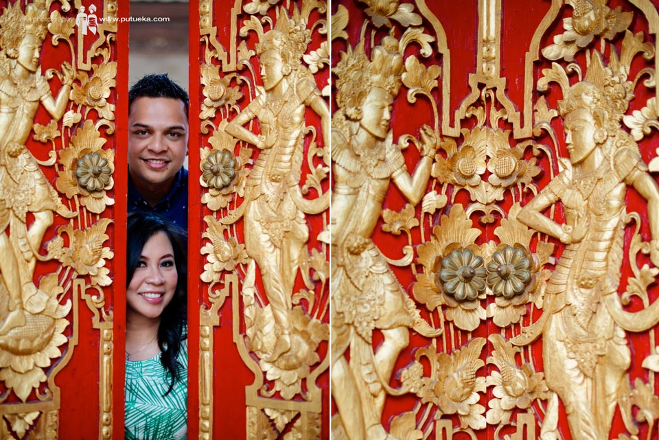 Looking outside from red gorgeous balinese door