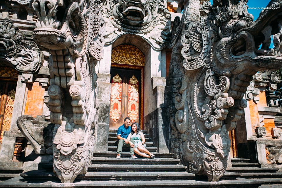 Sit down together in front of big balinese architecture
