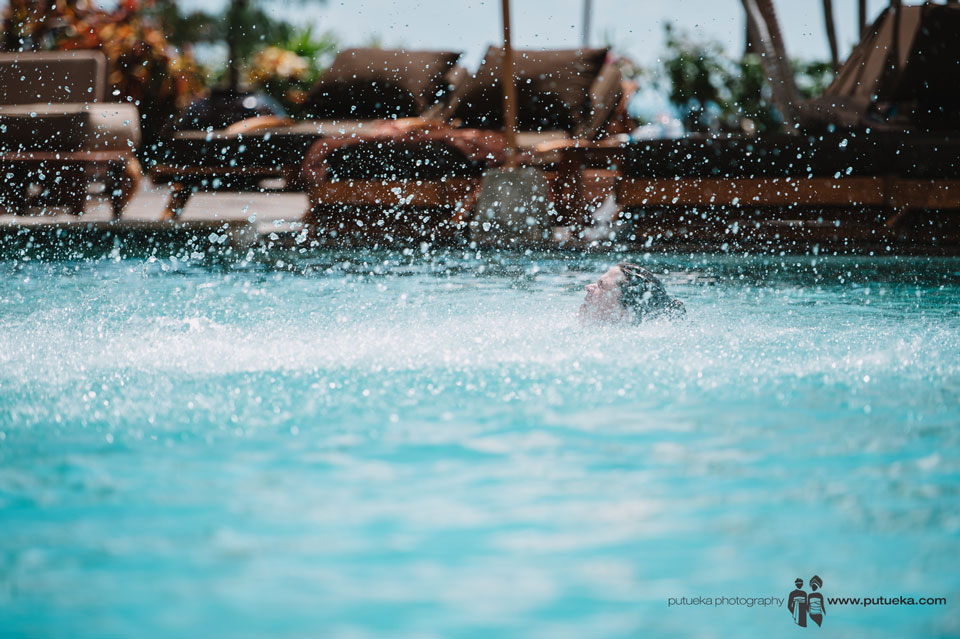 Water splash from Camille jump to the pool