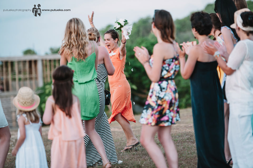 Happy expression from the girl who catch the bouquet