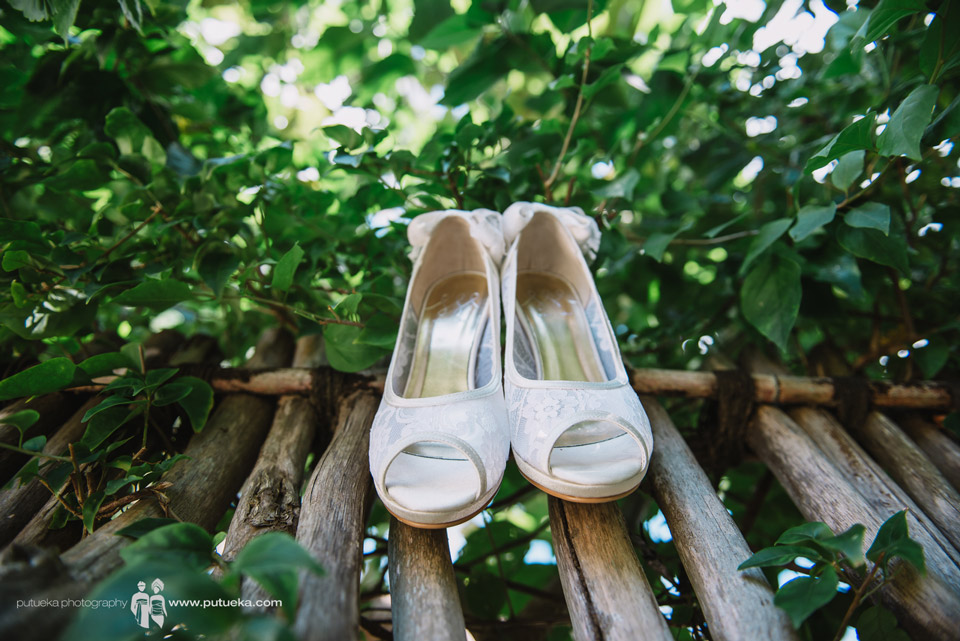 Camille wedding shoes hanging on the wood fence