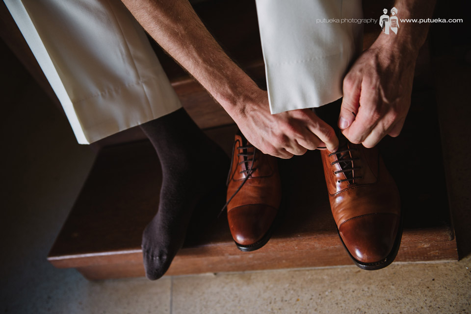 Perrick wearing his shoes for the wedding