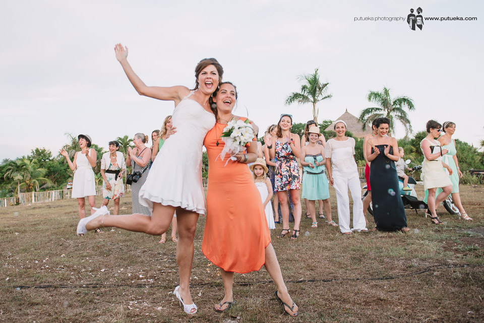 The bride and the girl who catch the bouquet on bouquet toss