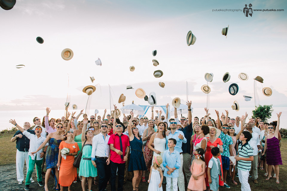 Throwing hats up in the air for Camille and Perrick wedding