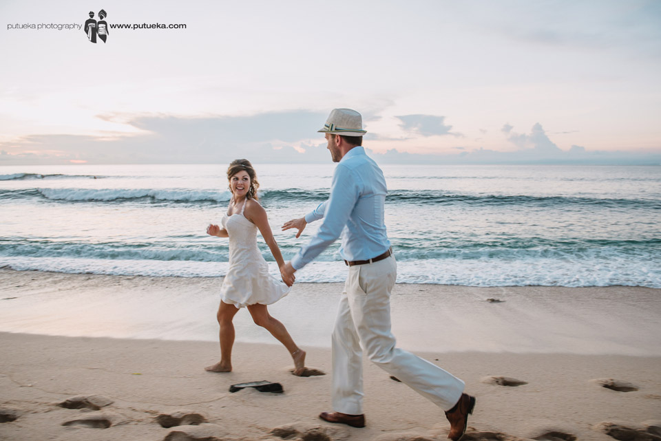 Running on the sand as a husband and wife