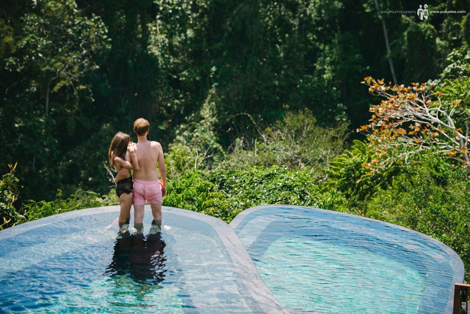 Evgeny and Julia standing on the edge of the pool