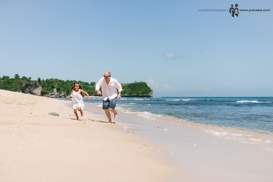 Running together along the shoreline