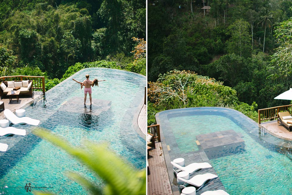 Evgeny carrying Julia in his arm on honeymoon photography, in the middle of no.1 pool in the world at Hanging Gardens of Bali