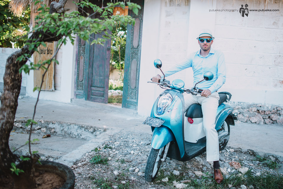 Perrick ready to ride blue scooter from villa to wedding venue