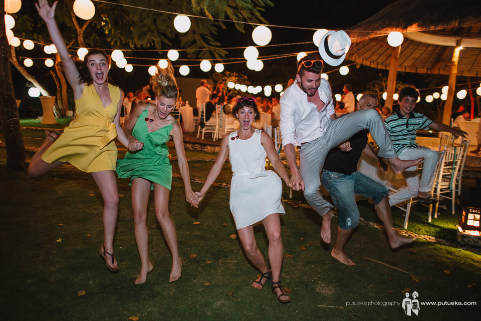 Jumping together as a sign of happiness for Camille and Perrick wedding