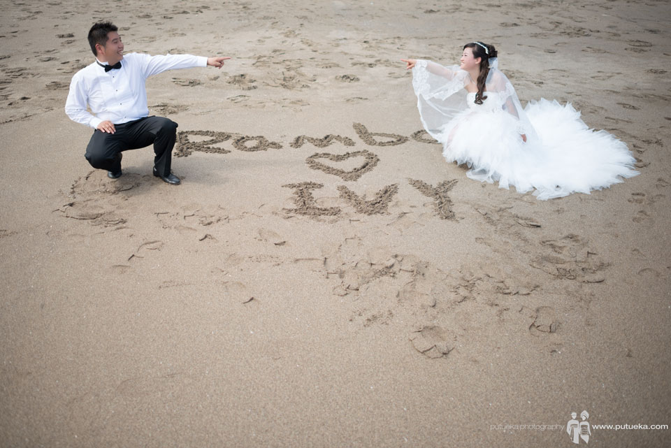 Rambo love Ivy sign on Bali sand beach