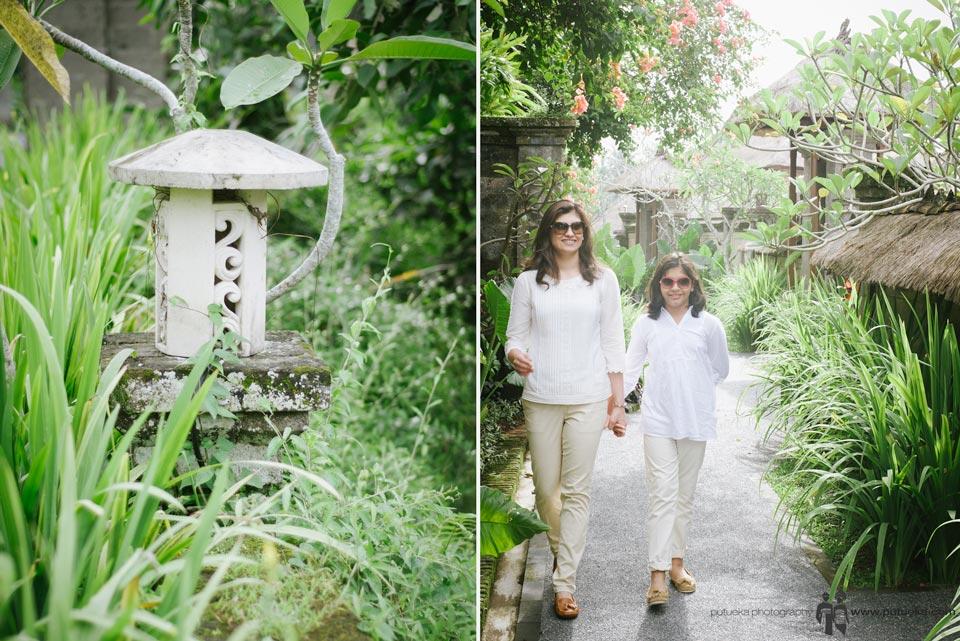 Walking through green lush Kamandalu Resort