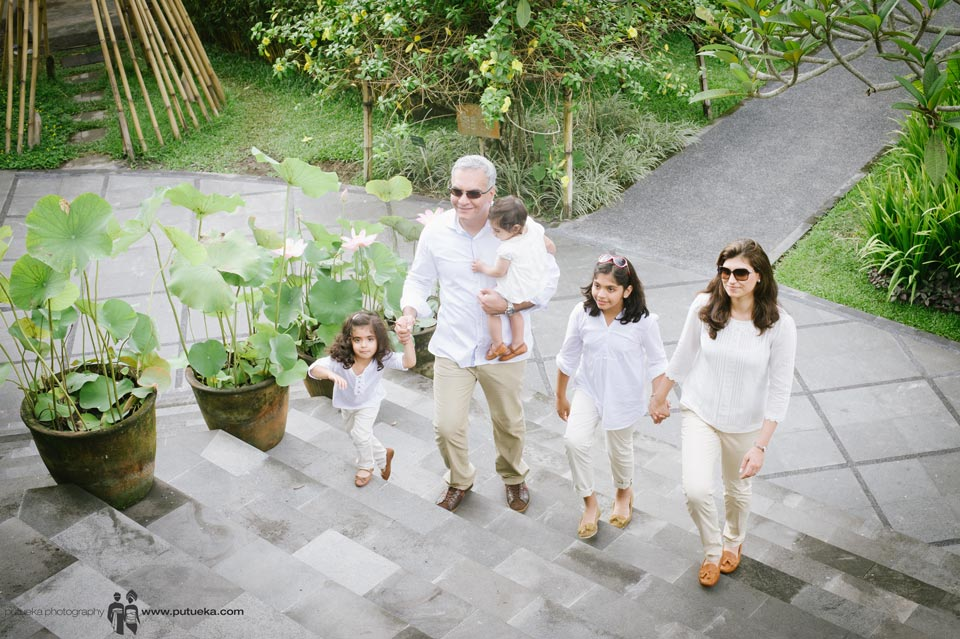 The whole family walking around inside Kamandalu resort