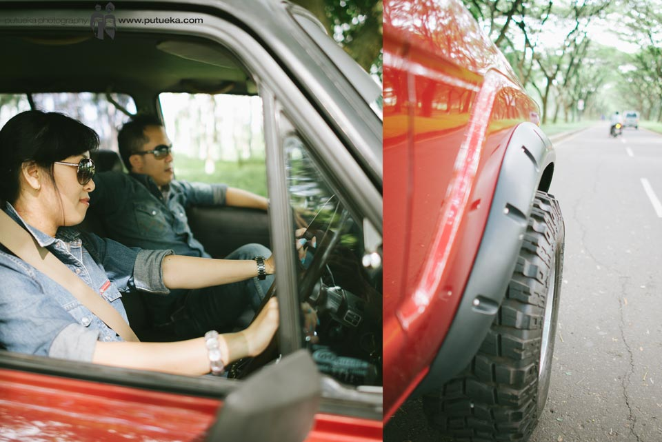 Driving together on big red Toyota Land Cruiser with offroad tire