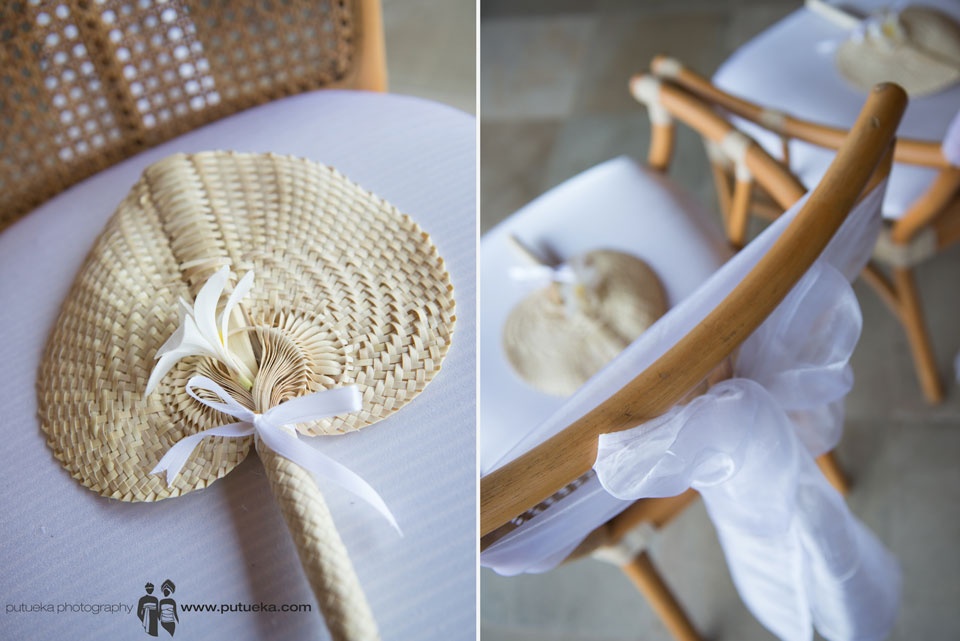 Hand fan for guest on the white brown chair