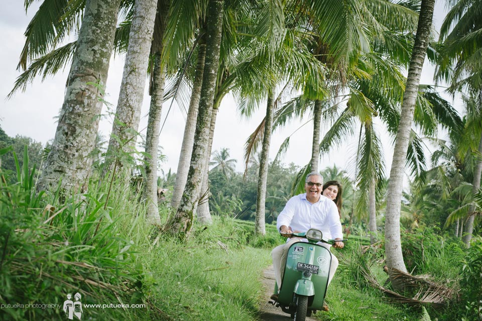 Family photography session in green lush of Ubud with green vespa