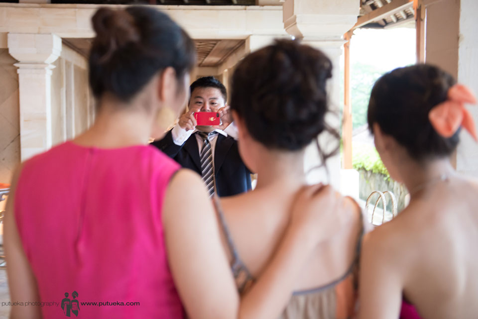 Taking photo with the bride