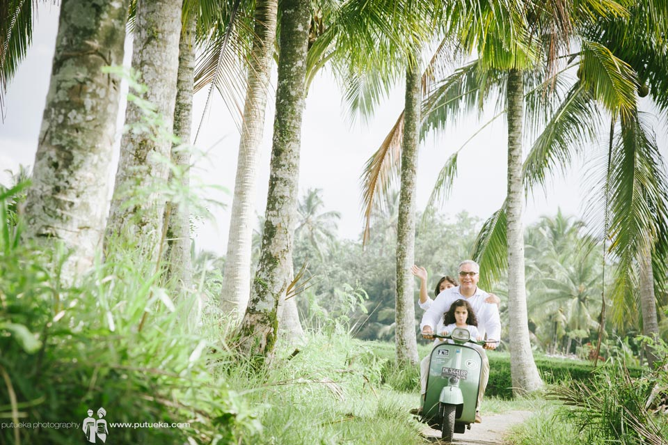 Memorable moment for the kids riding scooter with father in Ubud Bali