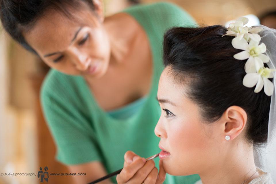 Makeup artist put lip colour on Jessie's lip