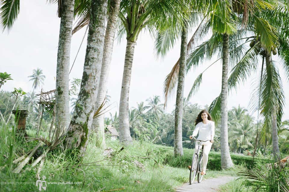 Unforgettable moment riding bicycle on family vacation photography session in Ubud Bali