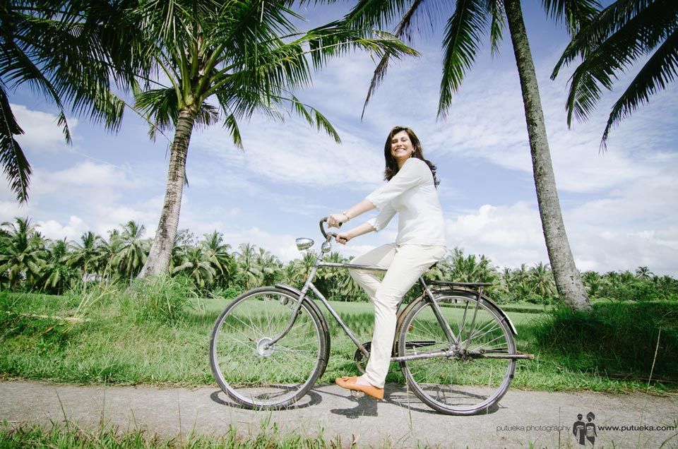 Big smile of mother while riding bicycle