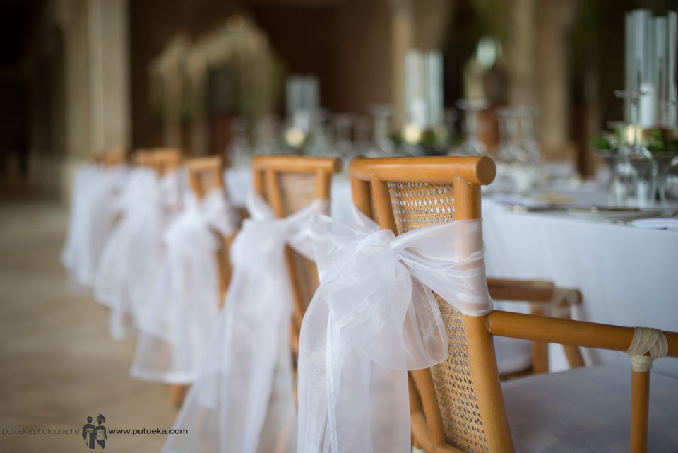 Dinner reception chair wrapped with white fabric