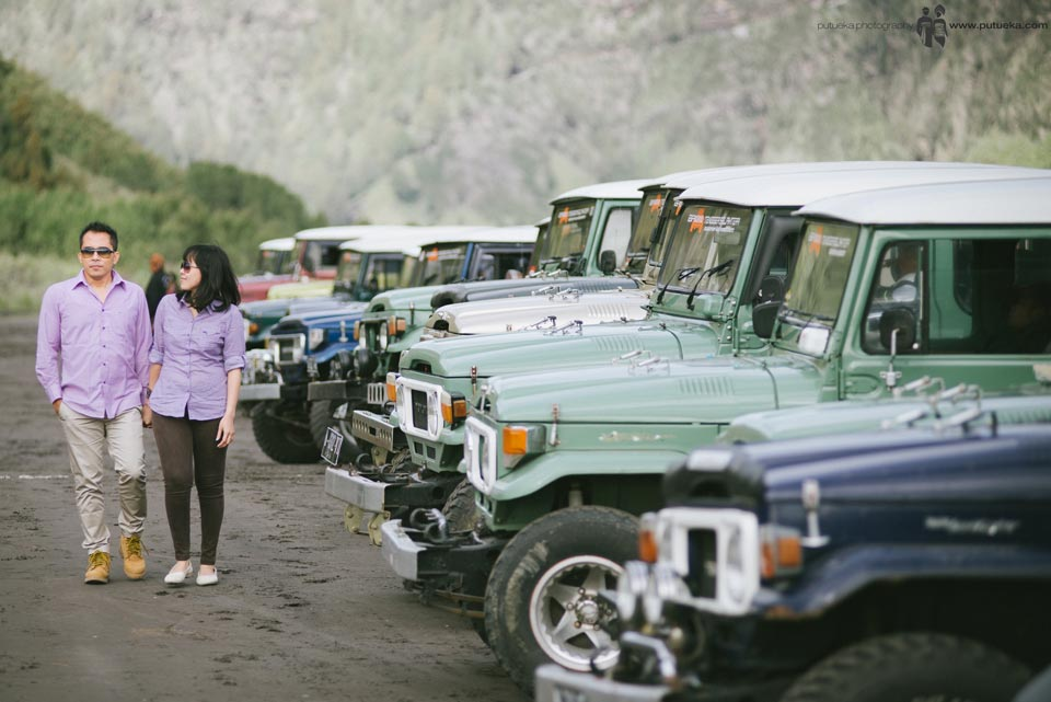 Walking along parked jeep at Bromo