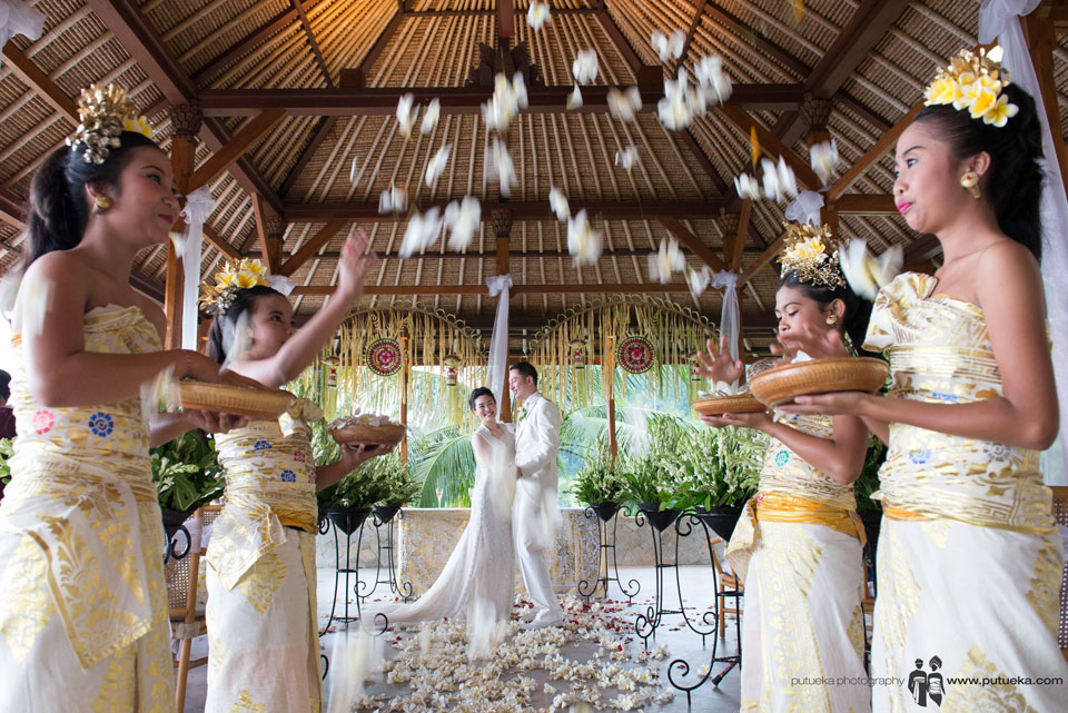 Boris and Jessie first dance under flower shower on their Amankila Bali wedding