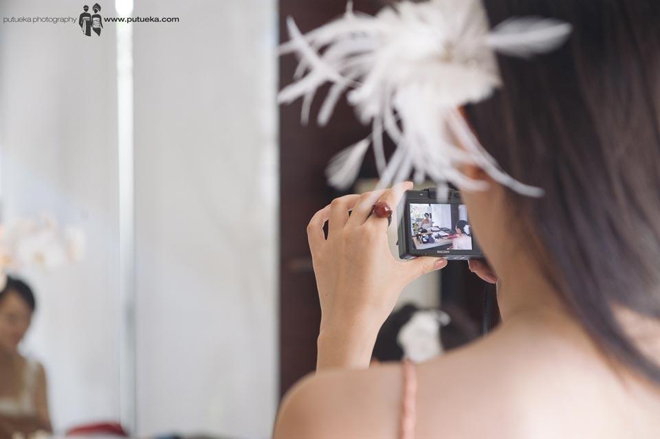 Bridesmaid capture bride wedding makeup session