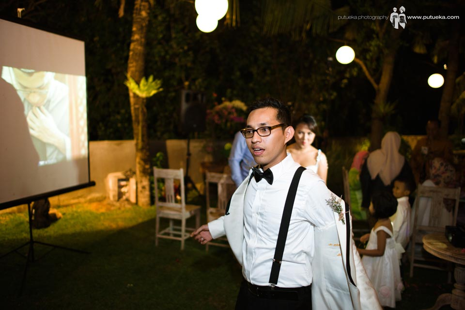 Hakim open his tuxedo in preparation to hit piñata