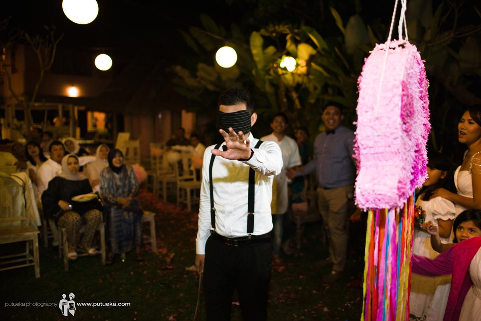 Hakim looking for piñata blindfolded