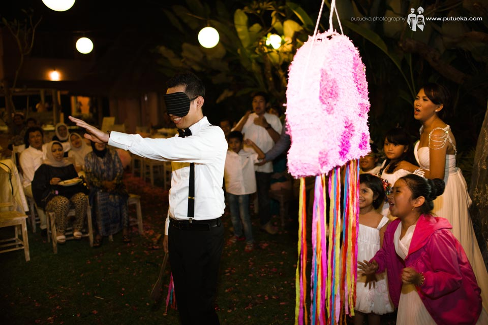 Hakim still looking piñata blindfolded