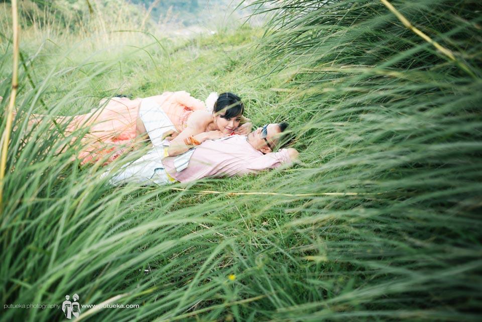 Kintamani Bali pre wedding photography session inside green lush grass