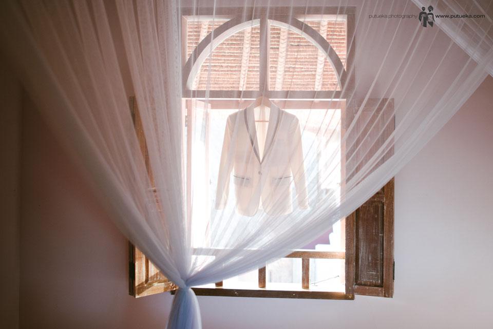 Hakim tuxedo hanging on the window