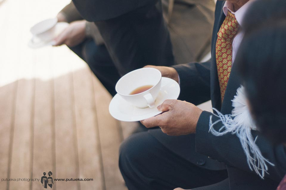 Father holding cup of tea