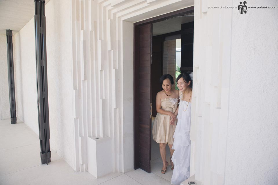 Bride going out from the room with her mother