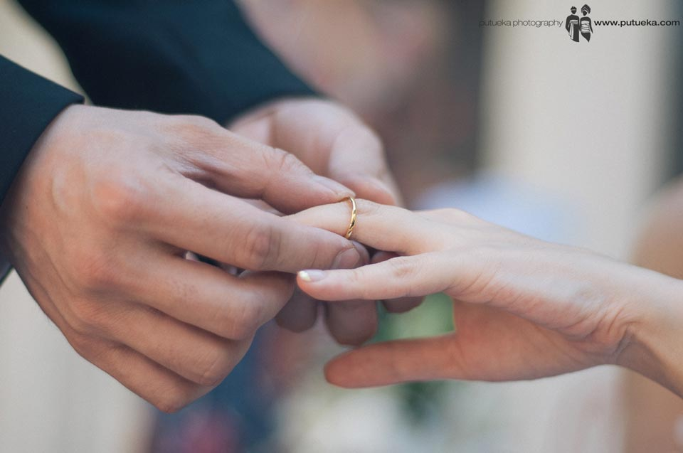 Groom put the wedding ring in to bride's finger
