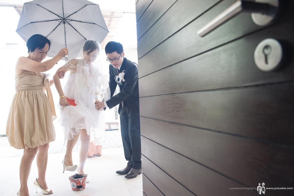 Bride stepping over before entering the room