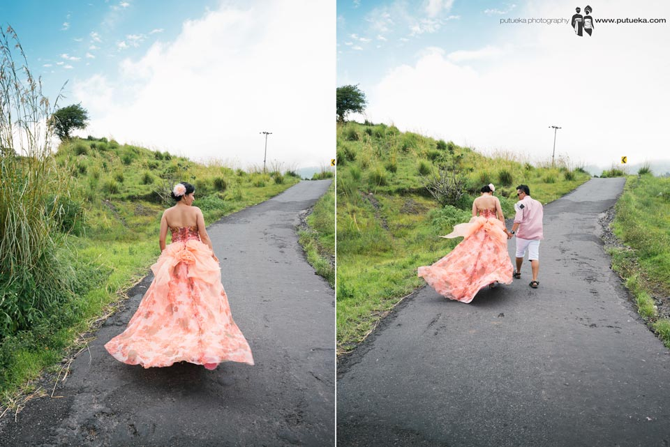 Walking together up hill at kintamani engagement session