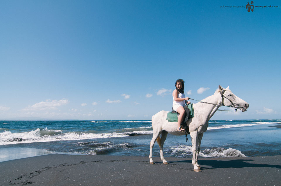 Unforgettable moment riding horse at the beach in the morning