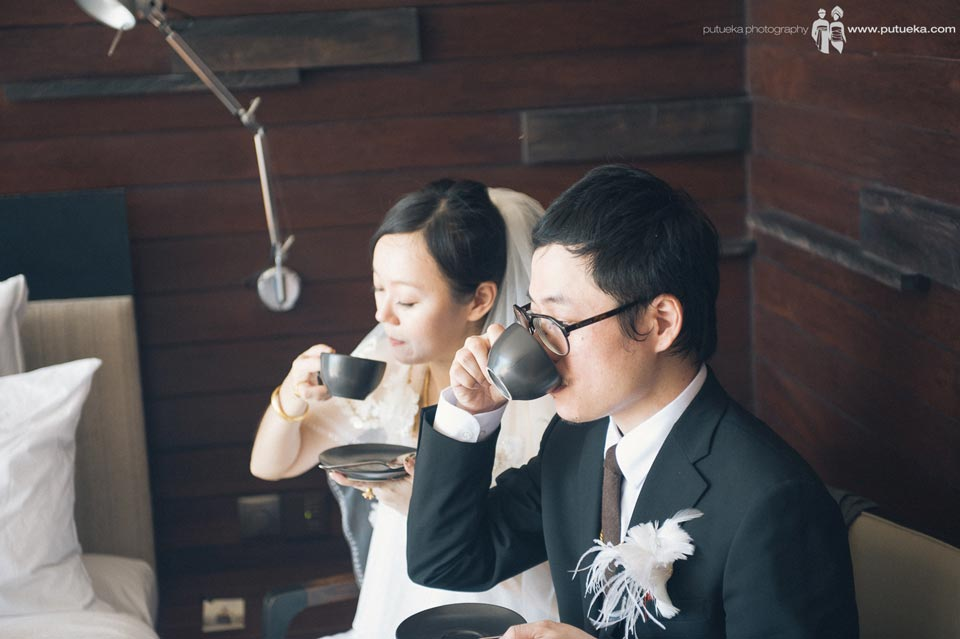 Bride and grrom drinking tea together