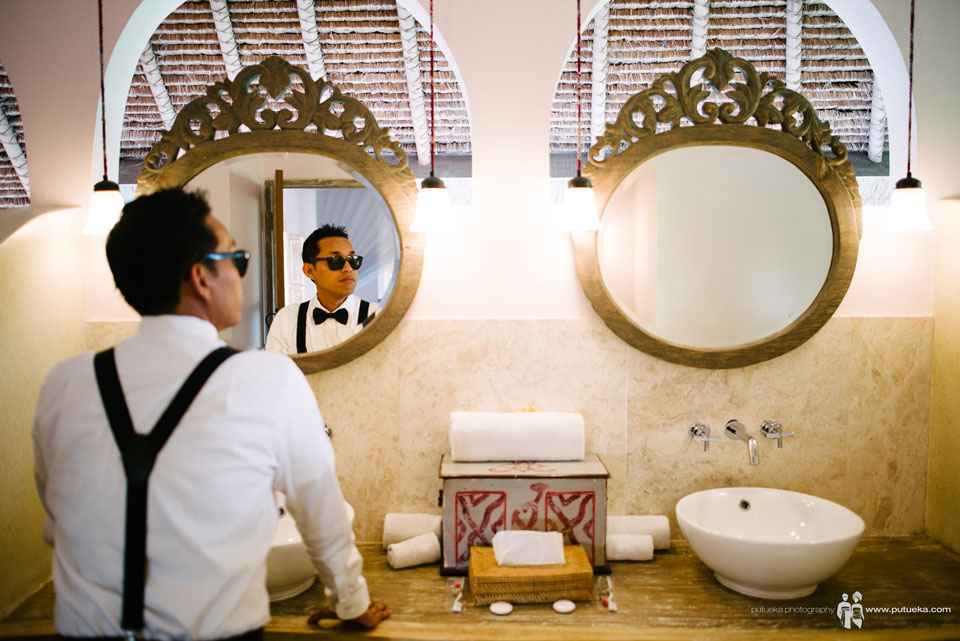 Hakim looking at himself on bathroom mirror