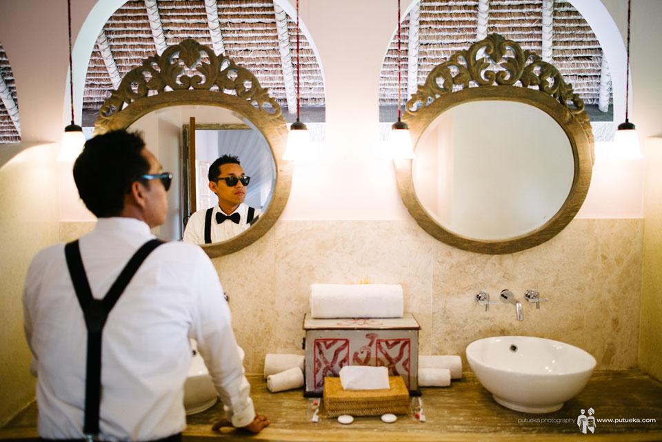 Hakim looking at himself on bathroom mirror