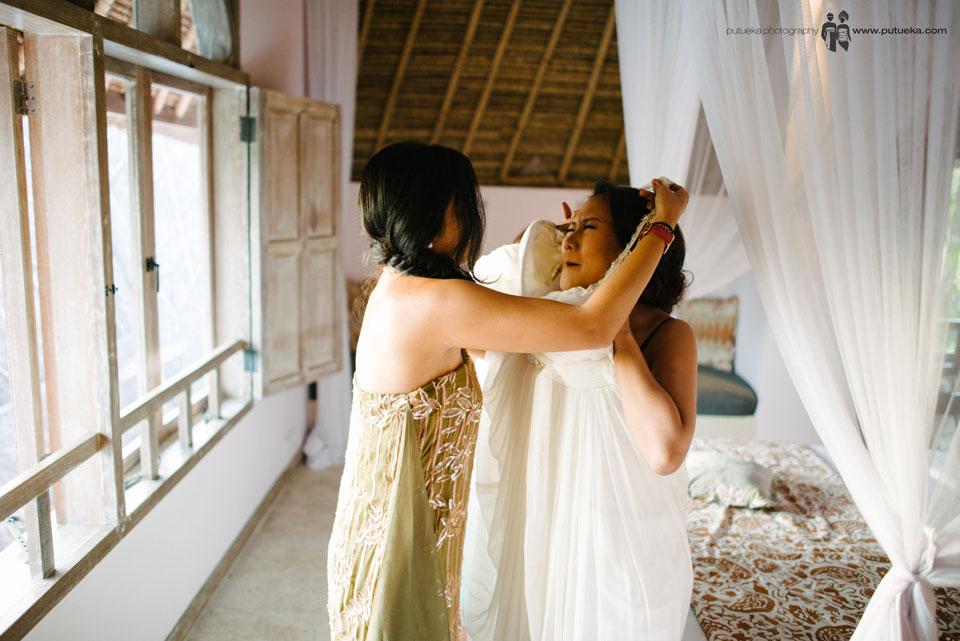 Ayu trying to wear the wedding dress