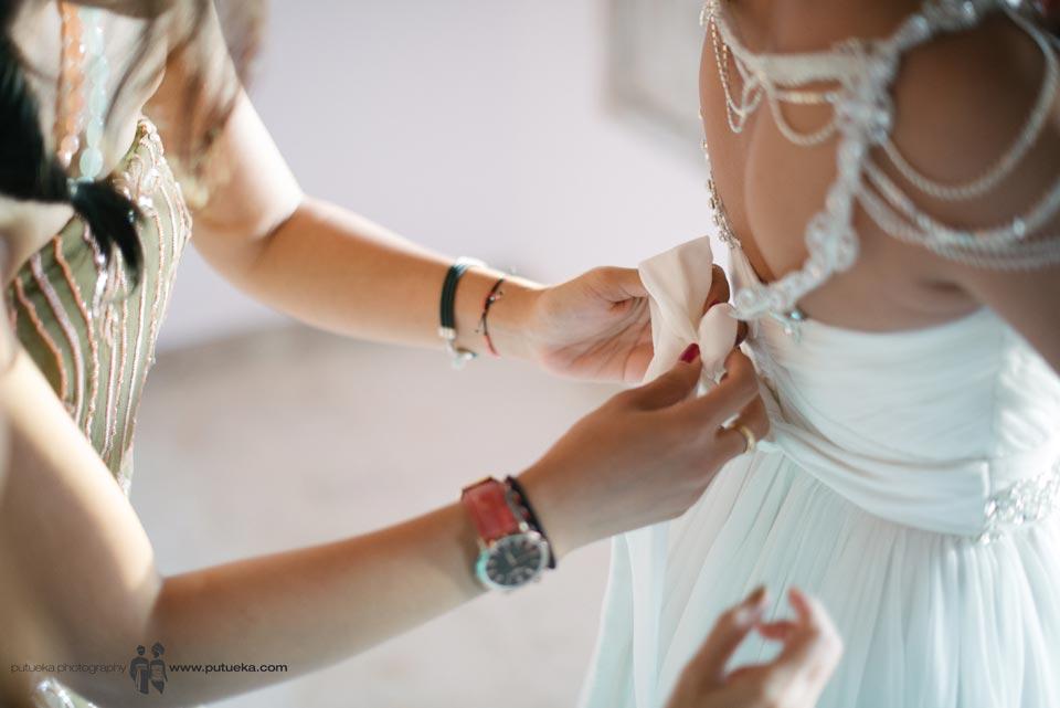 Bridesmaid help Ayu to tie the wedding dress