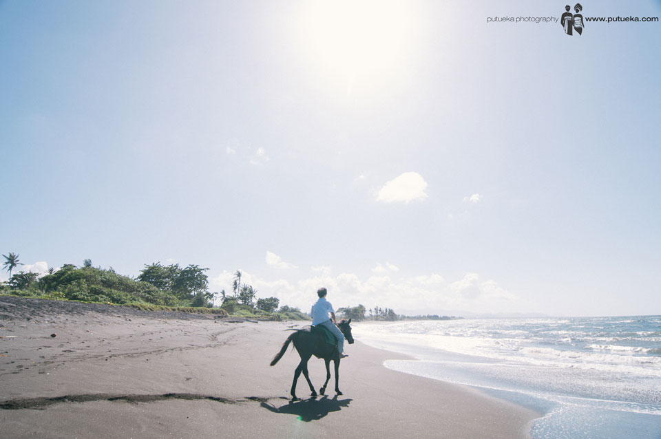 Sun shining when Jasmin Junus riding his horse at the beach
