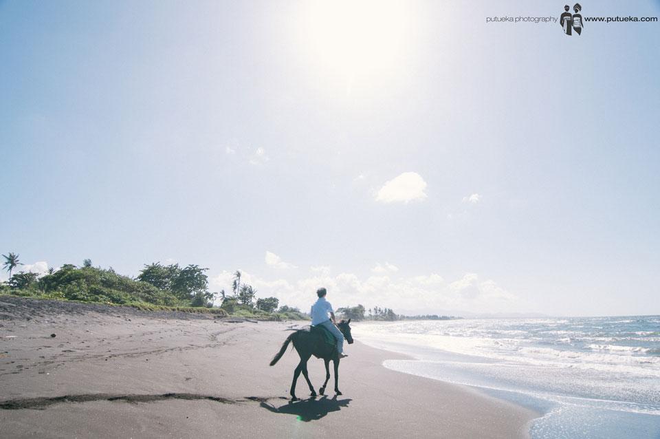 Sun shining when Jasmin Junus riding his horse at the beach