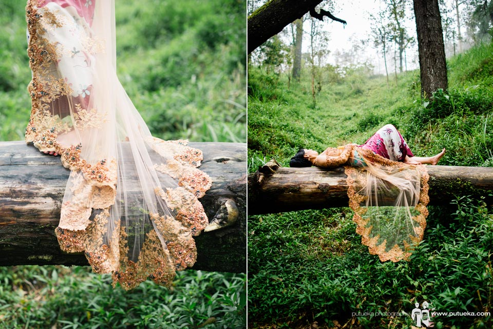 Laying down on big fallen tree wearing gorgeous kebaya on pre wedding session in Kintamani Bali