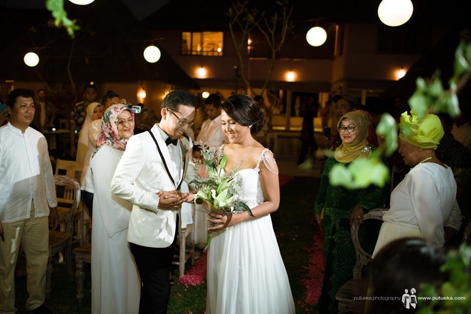 Brides and groom meet at wedding venue