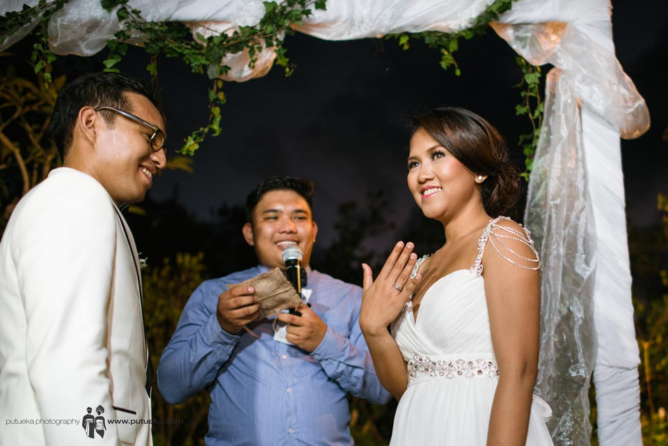 Brides show the ring to audience